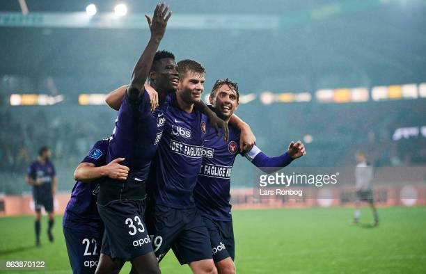 Mikkel Duelund Paul Onuachu Alexander Sorloth and Jakob Poulsen of FC Midtjylland celebrate after scoring their fourth goal during the Danish Alka...