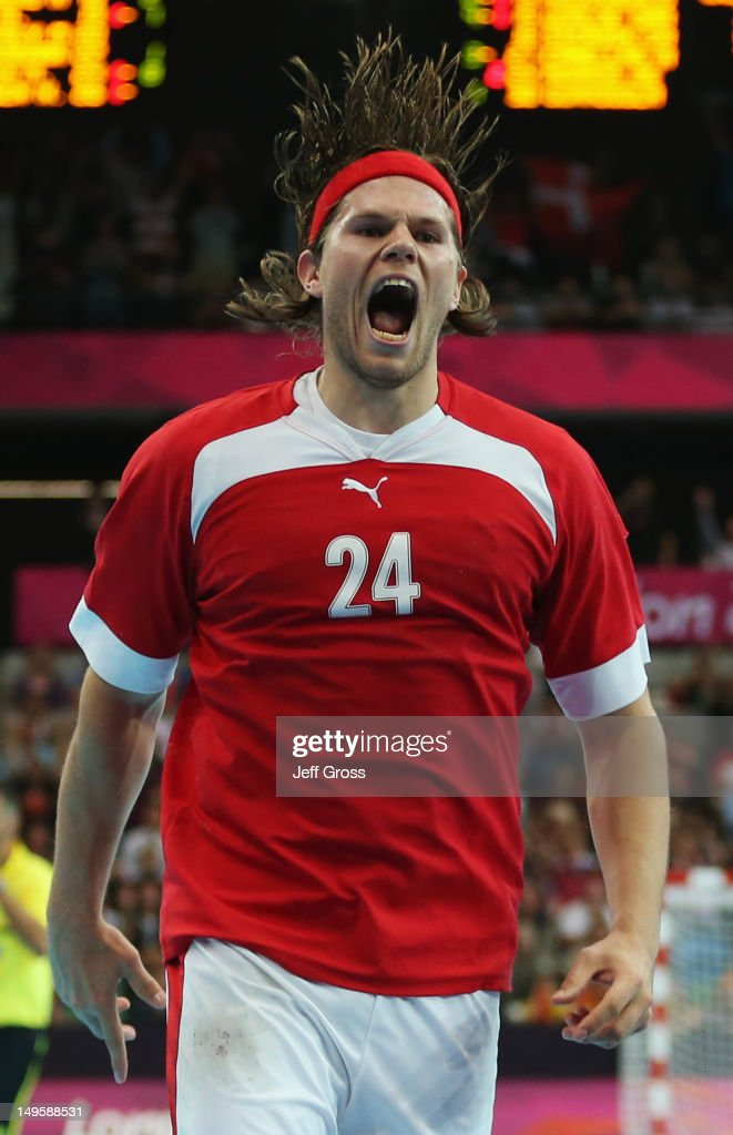 Mikkel Hansen of Denmark celebrates victory after the Men's Handball Preliminary match between Denmark and Spain on Day 4 of the London 2012 Olympic Games at The Copper Box on July 31, 2012 in London, England.