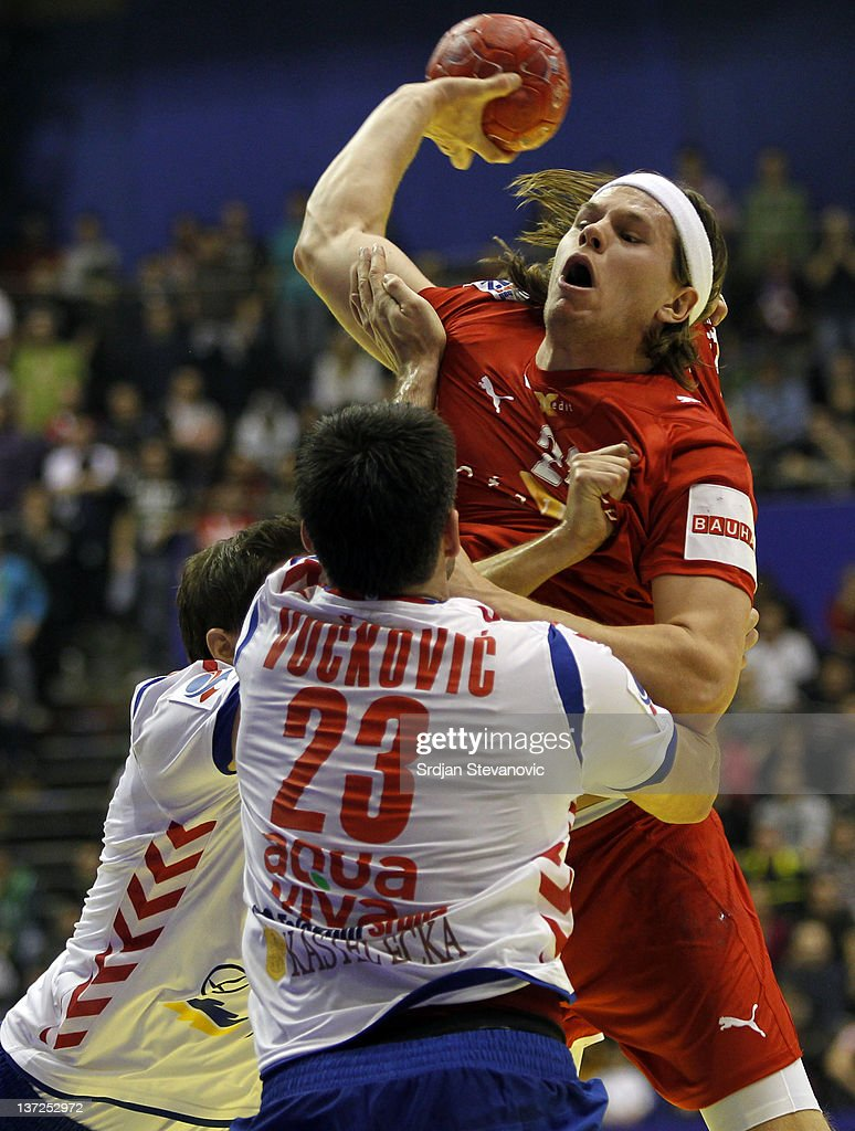 Mikkel Hansen (R) of Denmark competes with Nenad Vuckovic of Serbia during the Men's European Handball Championship 2012 group A match between Serbia and Denmark at Pionir Arena on January 17, 2011 in Belgrade, Serbia.