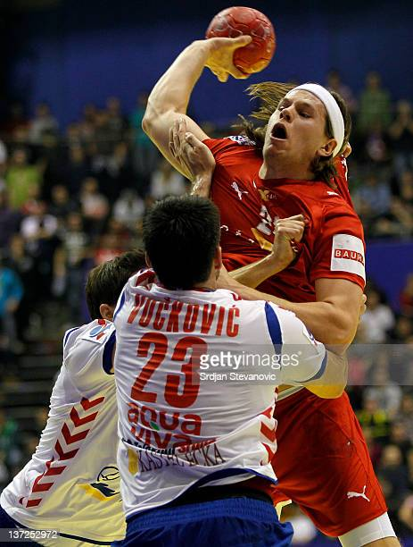 Mikkel Hansen of Denmark competes with Nenad Vuckovic of Serbia during the Men's European Handball Championship 2012 group A match between Serbia and...