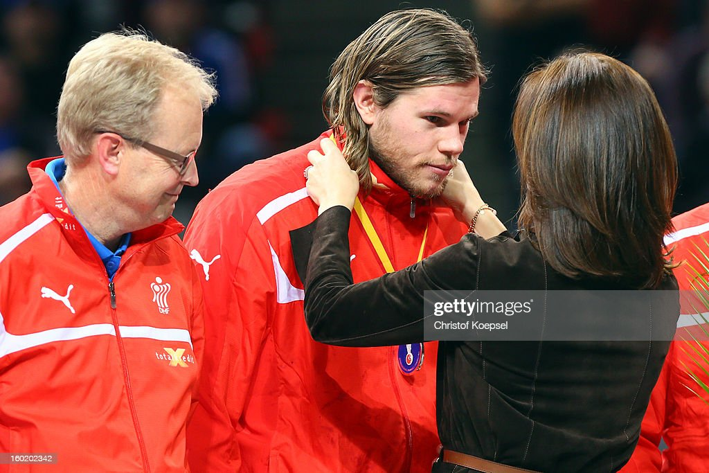 Mikkel Hansen of Denmark (C) gets the silver medal of Mary, crown princess of Denmark (R) on the podium after the Men's Handball World Championship 2013 final match between Spain and Denmark at Palau Sant Jordi on January 27, 2013 in Barcelona, Spain.