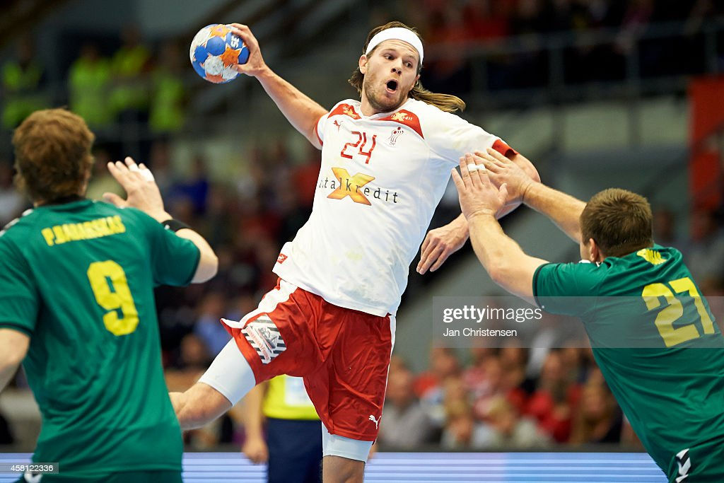 <a gi-track='captionPersonalityLinkClicked' href=/galleries/search?phrase=Mikkel+Hansen&family=editorial&specificpeople=5491088 ng-click='$event.stopPropagation()'>Mikkel Hansen</a> of Denmark in action during the MEN'S EHF EURO 2016 POLAND qualification between Denmark and Lithuania in Brondbyhallen on oktober 30, 2014 in Brondby, Denmark.