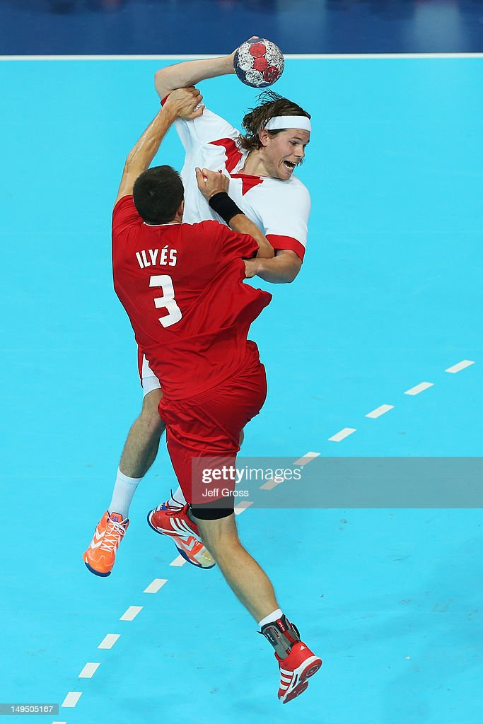 Mikkel Hansen of Denmark jumps to shoot while being under pressure by <a gi-track='captionPersonalityLinkClicked' href=/galleries/search?phrase=Ferenc+Ilyes&family=editorial&specificpeople=2084649 ng-click='$event.stopPropagation()'>Ferenc Ilyes</a> of Hungary during the Men's Handball preliminaries group B match between Hungary and Denmark on Day 2 of the London 2012 Olympic Games at the Copper Box on July 29, 2012 in London, England.