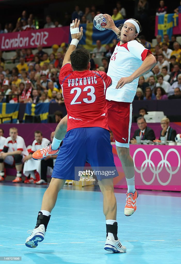 Mikkel Hansen #24 of Denmark shoots over Nenad Vuckovic #23 of Serbia in the Men's Preliminaries Group B match between Serbia and Denmark on Day 6 of the London 2012 Olympic Games at The Copper Box on August 2, 2012 in London, England.