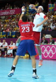 Mikkel Hansen of Denmark shoots over Nenad Vuckovic of Serbia in the Men's Preliminaries Group B match between Serbia and Denmark on Day 6 of the...