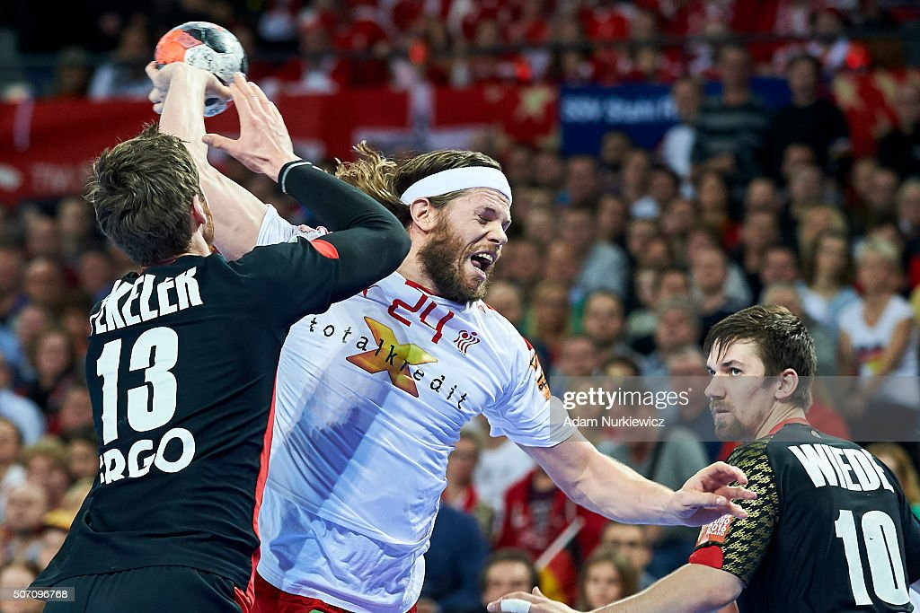 <a gi-track='captionPersonalityLinkClicked' href=/galleries/search?phrase=Mikkel+Hansen&family=editorial&specificpeople=5491088 ng-click='$event.stopPropagation()'>Mikkel Hansen</a> (C) of Denmark throws the ball against Hendrik Pekeler of Germany during the Men's EHF Handball European Championship 2016 match between Germany and Denmark at Centennial Hall on January 27, 2016 in Wroclaw, Poland.