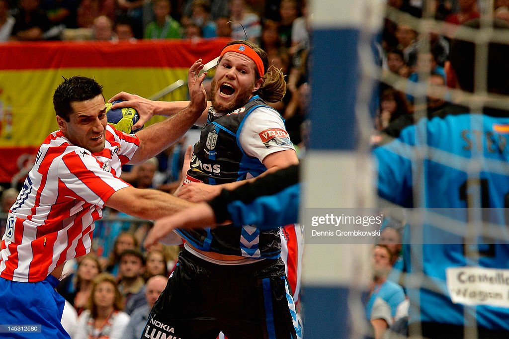 Mikkel Hansen of Kobenhavn is challenged by <a gi-track='captionPersonalityLinkClicked' href=/galleries/search?phrase=Kiril+Lazarov&family=editorial&specificpeople=3239733 ng-click='$event.stopPropagation()'>Kiril Lazarov</a> of Madrid during the EHF Final Four semi final match between BM Athletico Madrid and AG Kobenhavn at Lanxess Arena on May 26, 2012 in Cologne, Germany. at Lanxess Arena on May 26, 2012 in Cologne, Germany.
