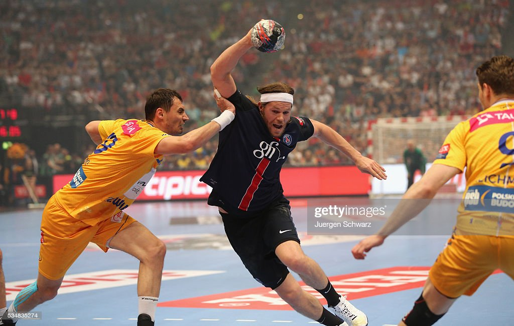 <a gi-track='captionPersonalityLinkClicked' href=/galleries/search?phrase=Mikkel+Hansen&family=editorial&specificpeople=5491088 ng-click='$event.stopPropagation()'>Mikkel Hansen</a> of Paris (C) controls the ball during the first semi-final of the EHF Final4 between VS Tauron Kielce and Paris Saint-Germain on May 28, 2016 in Cologne, Germany.