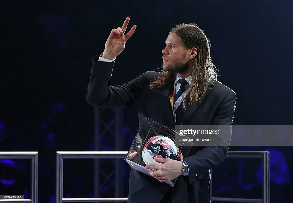 <a gi-track='captionPersonalityLinkClicked' href=/galleries/search?phrase=Mikkel+Hansen&family=editorial&specificpeople=5491088 ng-click='$event.stopPropagation()'>Mikkel Hansen</a> of Paris lifts his hand after receiving the trophy a top scorer of the season after the the EHF Champions League Final on May 29, 2016 in Cologne, Germany.