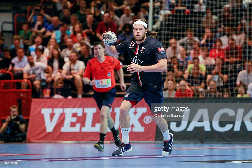 <a gi-track='captionPersonalityLinkClicked' href=/galleries/search?phrase=Mikkel+Hansen&family=editorial&specificpeople=5491088 ng-click='$event.stopPropagation()'>Mikkel Hansen</a> #24 of Paris Saint-Germain Handball brings the ball up during the EHF Men's Champions League Quarter Final game between Paris Saint-Germain Handball and MKB-MVM Veszprem at la Halle George Carpentier on April 12, 2015 in Paris, France.