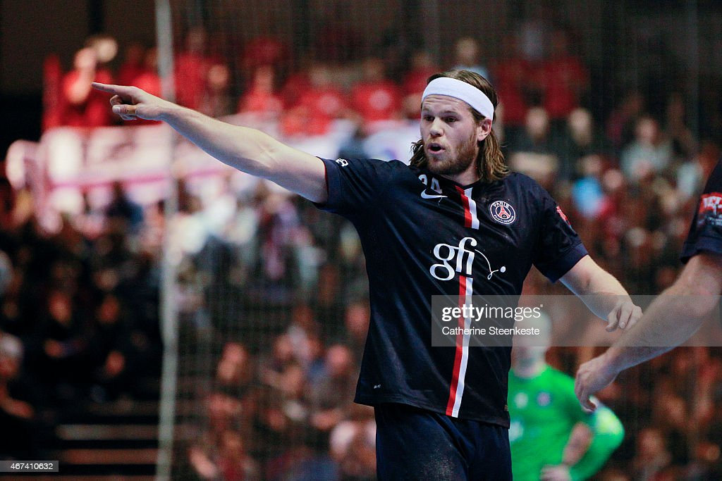 <a gi-track='captionPersonalityLinkClicked' href=/galleries/search?phrase=Mikkel+Hansen&family=editorial&specificpeople=5491088 ng-click='$event.stopPropagation()'>Mikkel Hansen</a> #24 of PSG Handball is calling a play during the last 16 VELUX EHF Champions League game between PSG Handball and Dunkerque HB Grand Littoral at La Halle Carpentier on March 22, 2015 in Paris, France.
