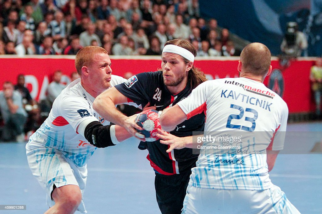 Mikkel Hansen of PSG Handball tries to shoot the ball against Matej Gaber and Vid Kavticnik of Montpellier Agglomeration Handball during the game...