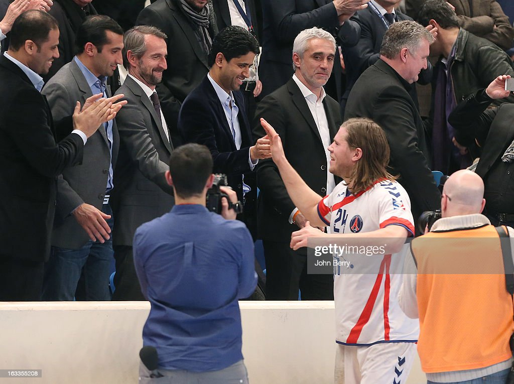 Mikkel Hansen of PSG shakes hands with Jean-Claude Blanc, director of PSG, Nasser Al-Khelaifi (president of PSG, football and handball) and Philippe Bernat-Salles (president of the french Handball National League) after the handball's Division 1 match between Paris Saint-Germain Handball and Dunkerque at the Stade Pierre de Coubertin on March 7, 2013 in Paris, France.