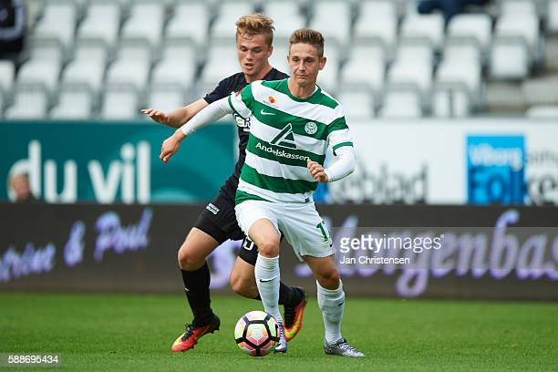 Mikkel Kallesoe of Randers FC and Andreas Bruhn of Viborg FF compete for the ball during the Danish Alka Superliga match between Viborg FF and...
