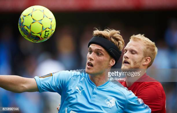 Mikkel Kallesoe of Randers FC and Nicolai Boilesen of FC Copenhagen compete for the ball during the Danish Alka Superliga match between Randers FC...