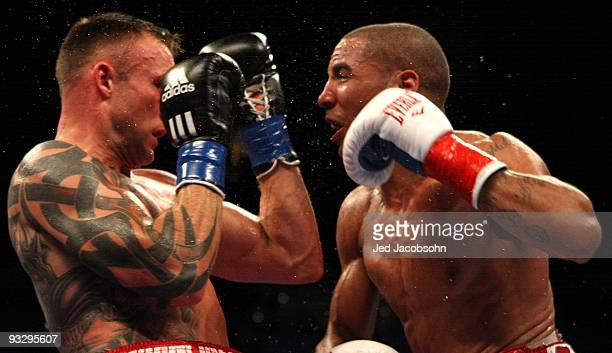 Mikkel Kessler of Denmark is hit by Andre Ward during their WBA Super Middleweight Championship Bout at the OaklandAlameda County Coliseum on...