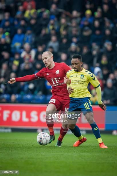 Mikkel Rygaard of Lyngby BK and Lebogang Phiri of Brondby IF the Danish Alka Superliga match between Brondby IF and Lyngby BK at Brondby Stadion on...