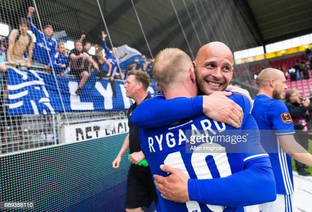 Mikkel Rygaard of Lyngby Boldklub and Thomas G Christensen of Lyngby Boldklub celebrates their victory after the Danish Alka Superliga match between...