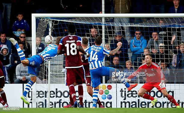Mikkel Vestergaard of Esbjerg fB scores the 12 goal on a header against Goalkeeper Stephan Andersen of FC Copenhagen during the Danish Alka Superliga...