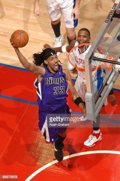 Mikki Moore of the Sacramento Kings goes up for a dunk against the Los Angeles Clippers at Staples Center on November 12 2008 in Los Angeles...