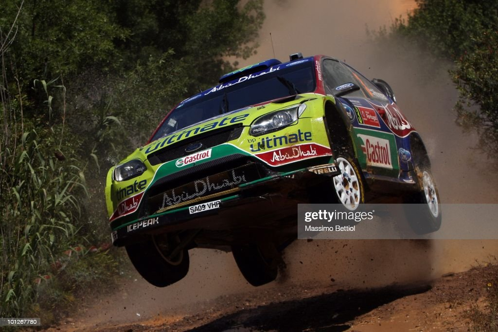 <a gi-track='captionPersonalityLinkClicked' href=/galleries/search?phrase=Mikko+Hirvonen&family=editorial&specificpeople=209287 ng-click='$event.stopPropagation()'>Mikko Hirvonen</a> of Finland and <a gi-track='captionPersonalityLinkClicked' href=/galleries/search?phrase=Jarmo+Lehtinen&family=editorial&specificpeople=233451 ng-click='$event.stopPropagation()'>Jarmo Lehtinen</a> of Finland compete in their BP Abu Dhabi Ford Focus during Leg 2 of the WRC Rally Portugal on May 29, 2010 in the Algarve, Portugal.