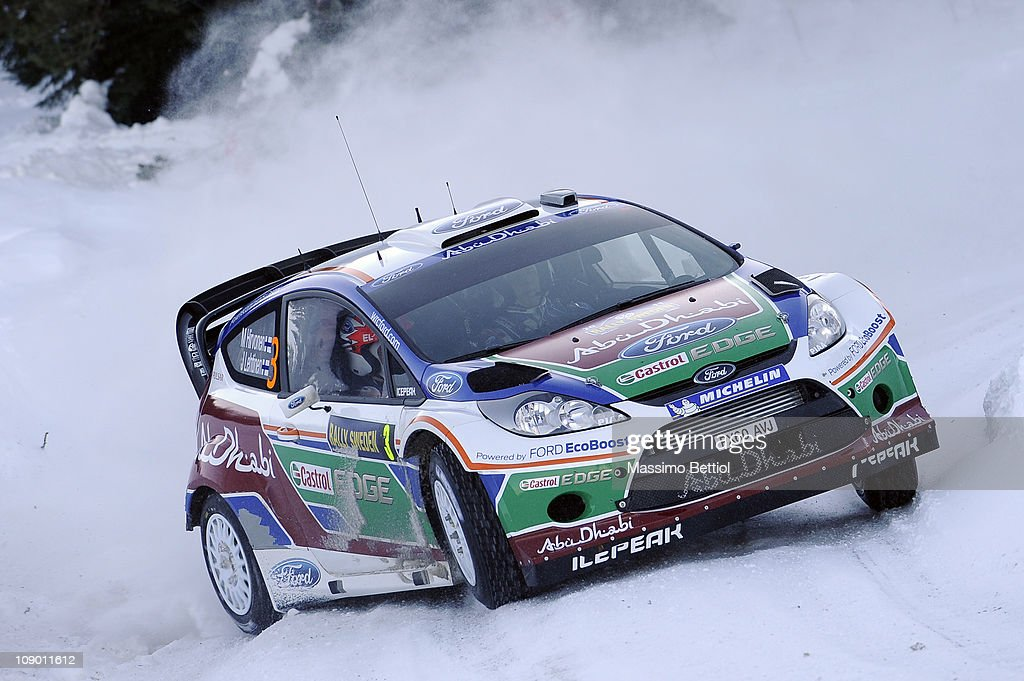 <a gi-track='captionPersonalityLinkClicked' href=/galleries/search?phrase=Mikko+Hirvonen&family=editorial&specificpeople=209287 ng-click='$event.stopPropagation()'>Mikko Hirvonen</a> of Finland and <a gi-track='captionPersonalityLinkClicked' href=/galleries/search?phrase=Jarmo+Lehtinen&family=editorial&specificpeople=233451 ng-click='$event.stopPropagation()'>Jarmo Lehtinen</a> of Finland compete in their Ford Abu Dhabi World Rally Team Ford Fiesta RS WRC during Leg1 of the WRC Rally of Sweden on February 11, 2011 in Karlstad, Sweden.