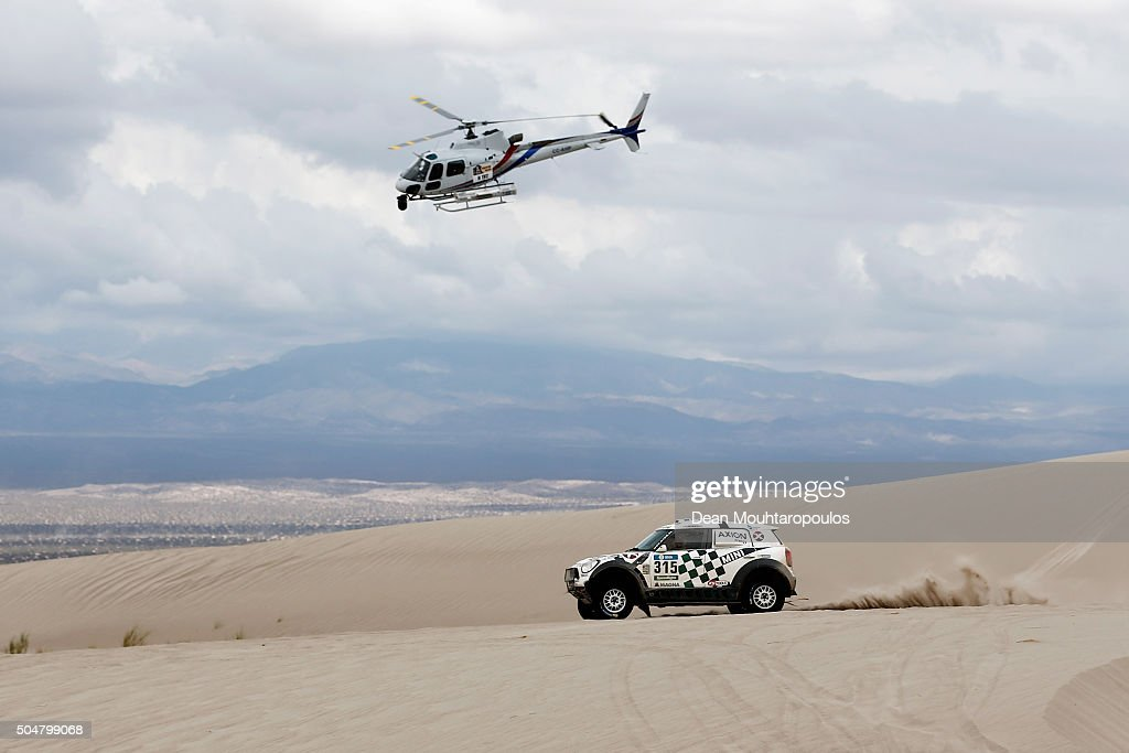 Mikko Hirvonen of Finland and Michel Perin of France in the MINI ALL4 RACING for AXION X-RAID TEAM are followed by the TV helicopter as they compete on day 11 stage ten between Belen and La Rioja during the 2016 Dakar Rally on January 13, 2016 in near Fiambala, Argentina.