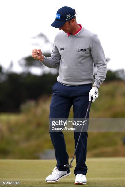 Mikko Ilonen of Finland celebrates a putt on the 8th green during day one of the AAM Scottish Open at Dundonald Links Golf Course on July 13 2017 in...