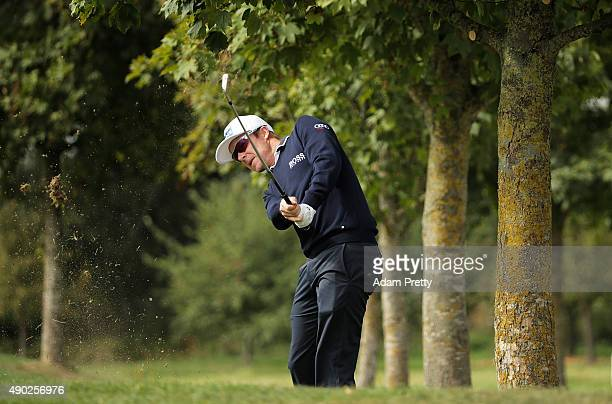 Mikko Ilonen of Finland hits out of the rough on hole 3 during the final round of the Porsche European Open at Golf Resort Bad Griesbach on September...