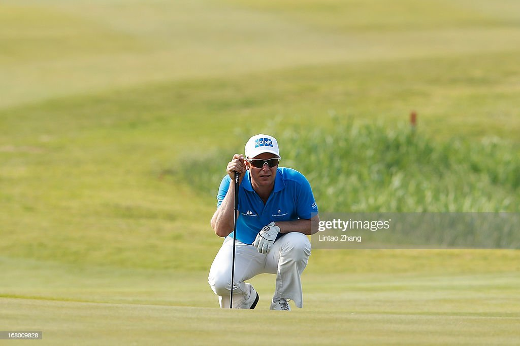 Mikko Ilonen of Finland lines up a putt during the third day of the Volvo China Open at Binhai Lake Golf Course on May 4, 2013 in Tianjin, China.