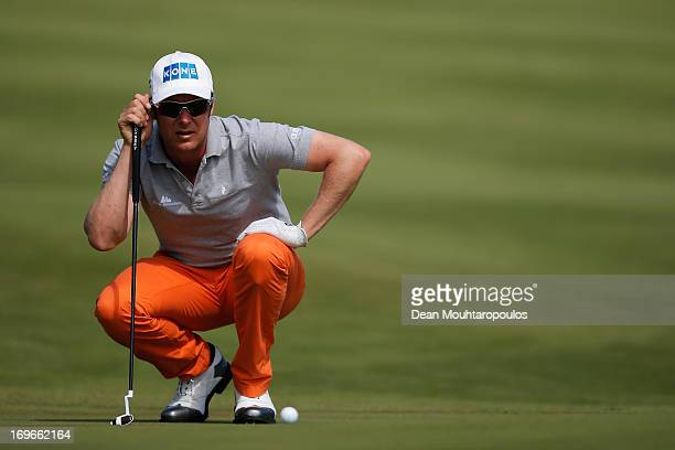 Mikko Ilonen of Finland lines up a putt on the 3rd green during Day One of the Nordea Scandinavian Masters at Bro Hof Slott Golf Club on May 30 2013...