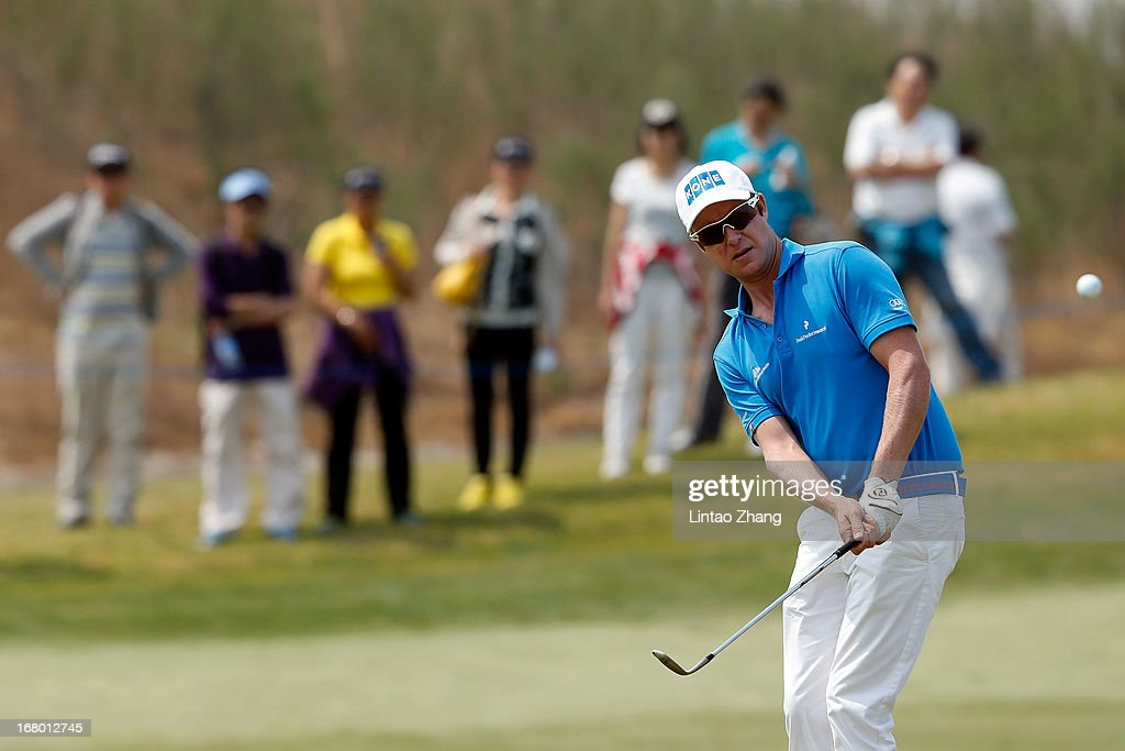<a gi-track='captionPersonalityLinkClicked' href=/galleries/search?phrase=Mikko+Ilonen&family=editorial&specificpeople=215042 ng-click='$event.stopPropagation()'>Mikko Ilonen</a> of Finland plays a shot during the third day of the Volvo China Open at Binhai Lake Golf Course on May 4, 2013 in Tianjin, China.
