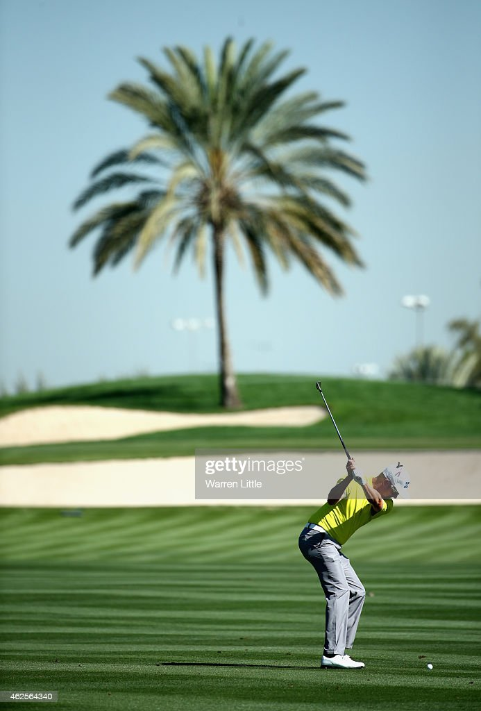 <a gi-track='captionPersonalityLinkClicked' href=/galleries/search?phrase=Mikko+Ilonen&family=editorial&specificpeople=215042 ng-click='$event.stopPropagation()'>Mikko Ilonen</a> of Finland plays his second shot into the first green during the third round of the Omega Dubai Desert Classic on the Majlis Course at the Emirates Golf Club on January 31, 2015 in Dubai, United Arab Emirates.