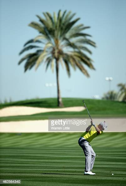 Mikko Ilonen of Finland plays his second shot into the first green during the third round of the Omega Dubai Desert Classic on the Majlis Course at...