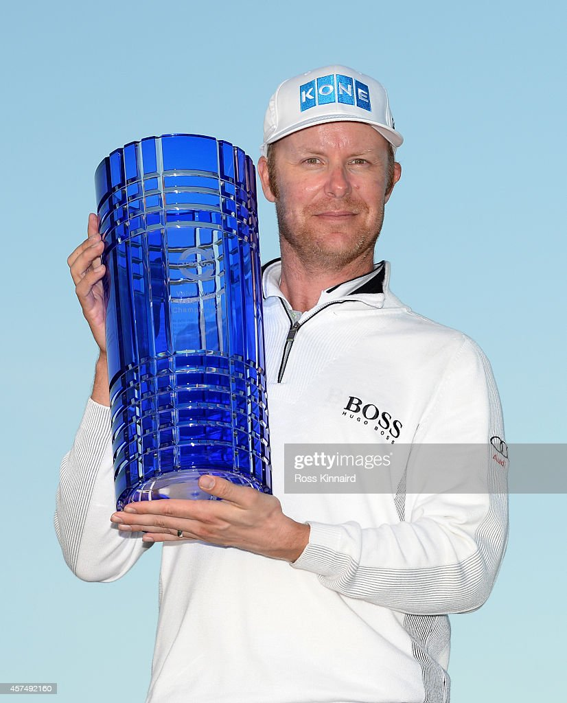 <a gi-track='captionPersonalityLinkClicked' href=/galleries/search?phrase=Mikko+Ilonen&family=editorial&specificpeople=215042 ng-click='$event.stopPropagation()'>Mikko Ilonen</a> of Finland with the winners trophy after defeating Henrik Stenson of Sweden 3&1 in the final of the Volvo World Match Play Championship at The London Club on October 19, 2014 in Ash, United Kingdom.