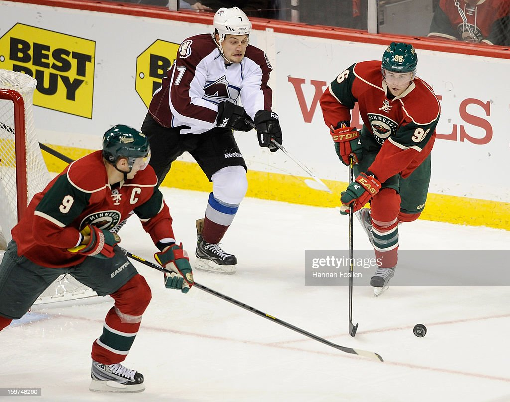 <a gi-track='captionPersonalityLinkClicked' href=/galleries/search?phrase=Mikko+Koivu&family=editorial&specificpeople=584987 ng-click='$event.stopPropagation()'>Mikko Koivu</a> #9 and <a gi-track='captionPersonalityLinkClicked' href=/galleries/search?phrase=Pierre-Marc+Bouchard&family=editorial&specificpeople=204628 ng-click='$event.stopPropagation()'>Pierre-Marc Bouchard</a> #96 of the Minnesota Wild and John Mitchell #7 of the Colorado Avalanche chase after a puck during the second period of the season opener on January 19, 2013 at Xcel Energy Center in St. Paul, Minnesota. The Wild defeated the Avalanche 4-2.