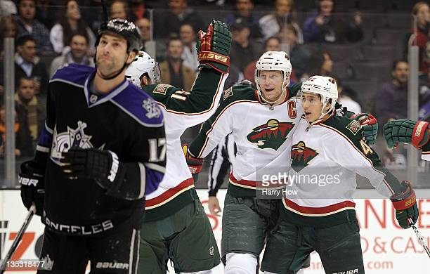 Mikko Koivu Jared Spurgeon and Dany Heatley of the Minnesota Wild celebrate a goal for a 10 lead in front of Ethan Moreau of the Los Angeles Kings...