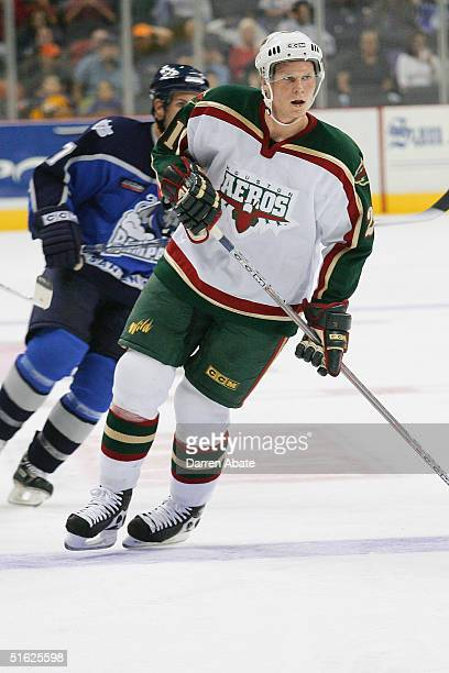 Mikko Koivu of the Houston Aeros skates back to the play during an AHL game against the San Antonio Rampage at the SBC Center San Antonio Texas The...