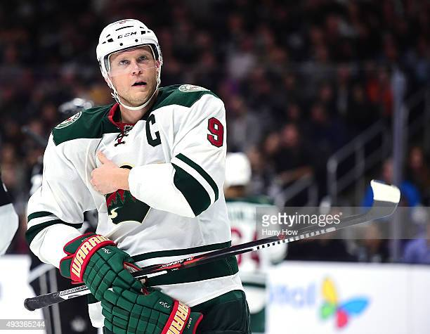 Mikko Koivu of the Minnesota Wild adjusts his equipment before a faceoff during the game against the Los Angeles Kings at Staples Center on October...