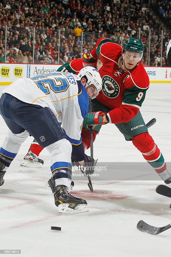 <a gi-track='captionPersonalityLinkClicked' href=/galleries/search?phrase=Mikko+Koivu&family=editorial&specificpeople=584987 ng-click='$event.stopPropagation()'>Mikko Koivu</a> #9 of the Minnesota Wild and <a gi-track='captionPersonalityLinkClicked' href=/galleries/search?phrase=David+Backes&family=editorial&specificpeople=2538492 ng-click='$event.stopPropagation()'>David Backes</a> #42 of the St. Louis Blues face off during the game on April 1, 2013 at the Xcel Energy Center in Saint Paul, Minnesota.