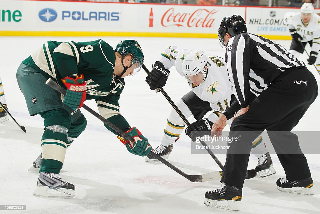 <a gi-track='captionPersonalityLinkClicked' href=/galleries/search?phrase=Mikko+Koivu&family=editorial&specificpeople=584987 ng-click='$event.stopPropagation()'>Mikko Koivu</a> #9 of the Minnesota Wild and <a gi-track='captionPersonalityLinkClicked' href=/galleries/search?phrase=Derek+Roy&family=editorial&specificpeople=203272 ng-click='$event.stopPropagation()'>Derek Roy</a> #11 of the Dallas Stars face off during the game on January 20, 2013 at the Xcel Energy Center in Saint Paul, Minnesota.