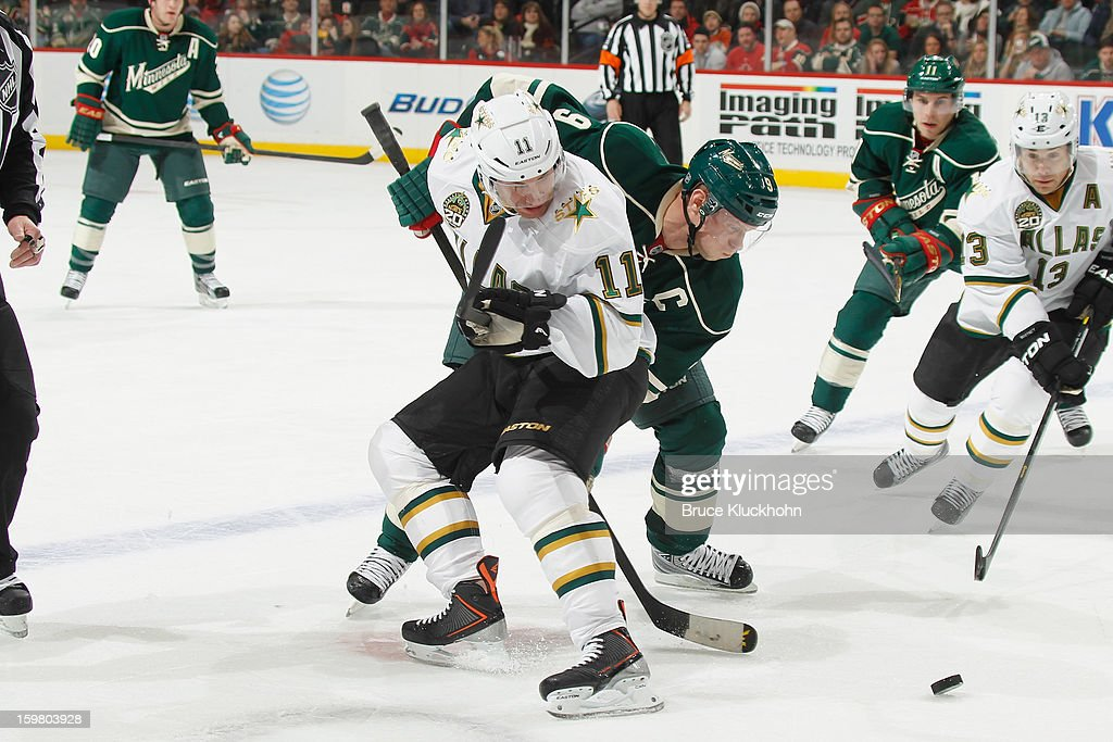 <a gi-track='captionPersonalityLinkClicked' href=/galleries/search?phrase=Mikko+Koivu&family=editorial&specificpeople=584987 ng-click='$event.stopPropagation()'>Mikko Koivu</a> #9 of the Minnesota Wild and <a gi-track='captionPersonalityLinkClicked' href=/galleries/search?phrase=Derek+Roy&family=editorial&specificpeople=203272 ng-click='$event.stopPropagation()'>Derek Roy</a> #11 of the Dallas Stars battle for control of the puck during the game on January 20, 2013 at the Xcel Energy Center in Saint Paul, Minnesota.
