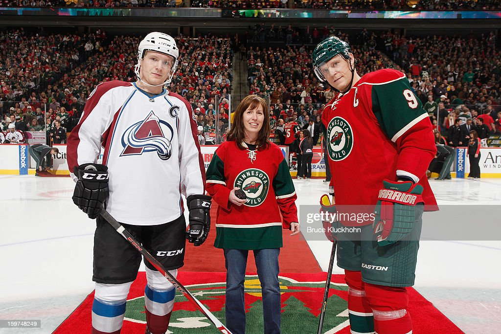 <a gi-track='captionPersonalityLinkClicked' href=/galleries/search?phrase=Mikko+Koivu&family=editorial&specificpeople=584987 ng-click='$event.stopPropagation()'>Mikko Koivu</a> #9 of the Minnesota Wild and <a gi-track='captionPersonalityLinkClicked' href=/galleries/search?phrase=Gabriel+Landeskog&family=editorial&specificpeople=6590816 ng-click='$event.stopPropagation()'>Gabriel Landeskog</a> #92 of the Colorado Avalanche stand with a fan during the honorary puck drop prior to the game on January 19, 2013 at the Xcel Energy Center in Saint Paul, Minnesota.