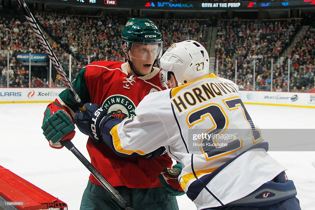 Mikko Koivu #9 of the Minnesota Wild and Patric Hornqvist #27 of the Nashville Predators are called for roughing penalties late in the first period during the game on January 22, 2013 at the Xcel Energy Center in Saint Paul, Minnesota.