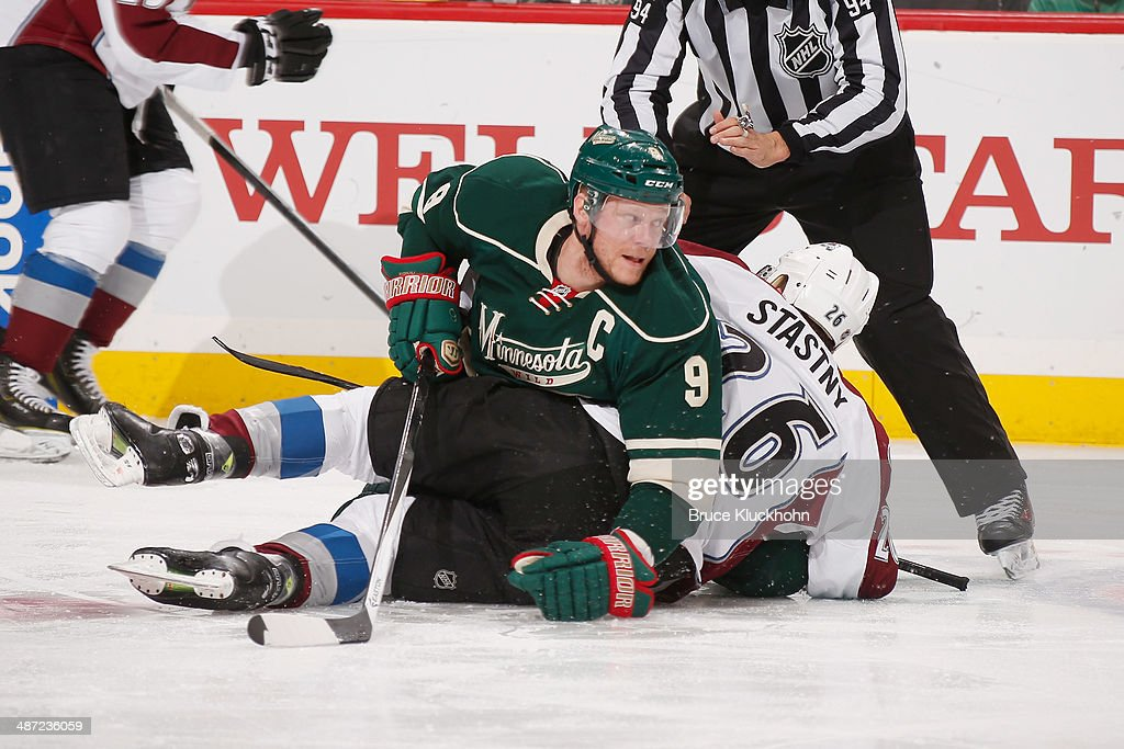 Mikko Koivu #9 of the Minnesota Wild and Paul Stastny #26 of the Colorado Avalanche get tangled up during Game Six of the First Round of the 2014 Stanley Cup Playoffs on April 28, 2014 at the Xcel Energy Center in St. Paul, Minnesota.