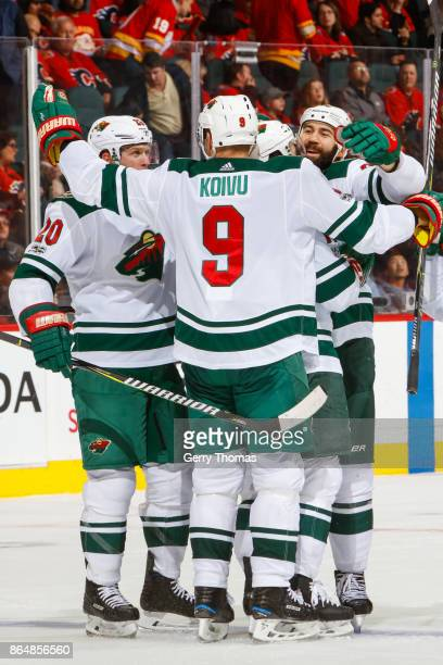 Mikko Koivu of the Minnesota Wild and teammates celebrate after scoring in an NHL game against the Calgary Flames at the Scotiabank Saddledome on...