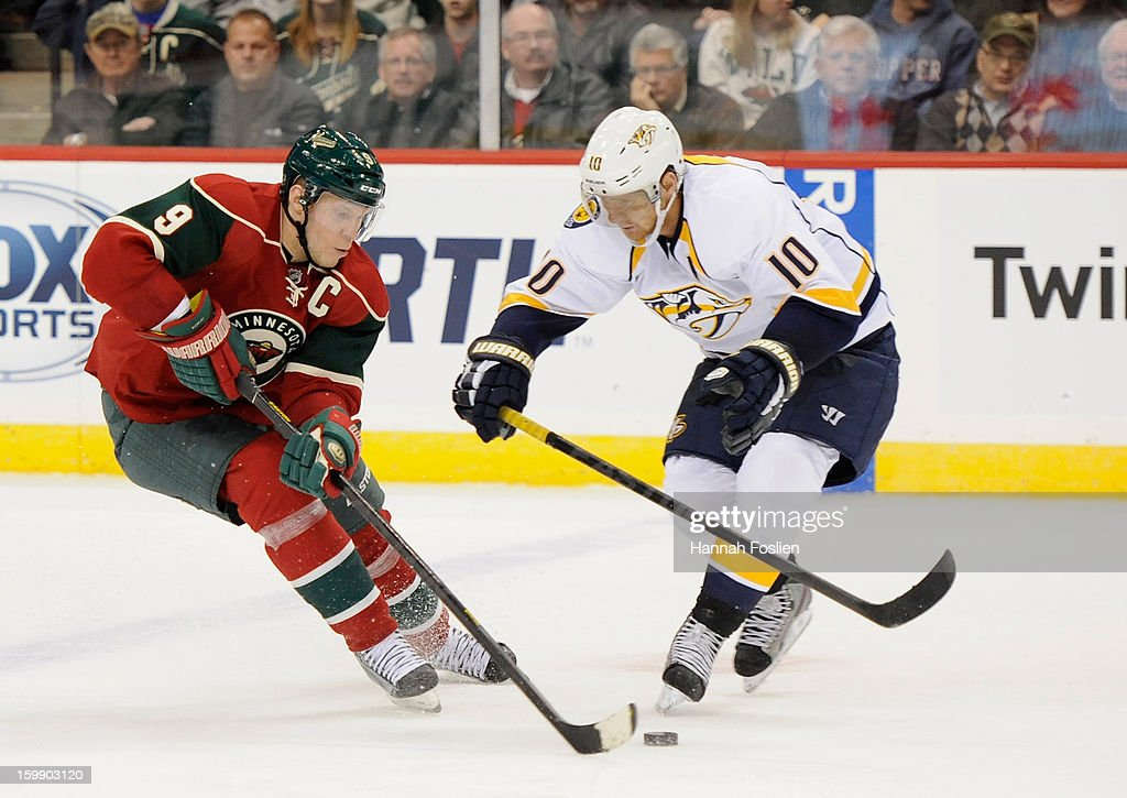 <a gi-track='captionPersonalityLinkClicked' href=/galleries/search?phrase=Mikko+Koivu&family=editorial&specificpeople=584987 ng-click='$event.stopPropagation()'>Mikko Koivu</a> #9 of the Minnesota Wild attempts to get the puck away from <a gi-track='captionPersonalityLinkClicked' href=/galleries/search?phrase=Martin+Erat&family=editorial&specificpeople=210561 ng-click='$event.stopPropagation()'>Martin Erat</a> #10 of the Nashville Predators during the second period of the game on January 22, 2013 at Xcel Energy Center in St Paul, Minnesota. The Predators defeated the Wild 3-1.