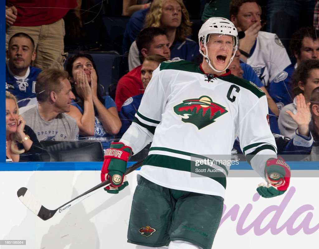 <a gi-track='captionPersonalityLinkClicked' href=/galleries/search?phrase=Mikko+Koivu&family=editorial&specificpeople=584987 ng-click='$event.stopPropagation()'>Mikko Koivu</a> #9 of the Minnesota Wild celebrates his goal against the Tampa Bay Lightning during the third period at the Tampa Bay Times Forum on October 17, 2013 in Tampa, Florida.