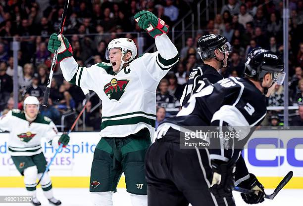 Mikko Koivu of the Minnesota Wild celebrates his goal to tie the game 11 behind Jeff Carter and Brayden McNabb of the Los Angeles Kings during the...
