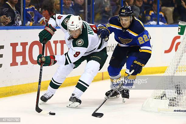 Mikko Koivu of the Minnesota Wild controls the puck against Kevin Shattenkirk of the St Louis Blues in Game Five of the Western Conference...